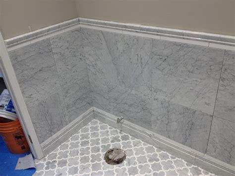 how to install floor tile in bathroom wood floors