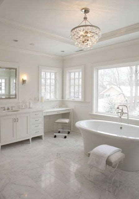 all white bathroom 15 ways to rock glam chandeliers in bathrooms shelterness 10082