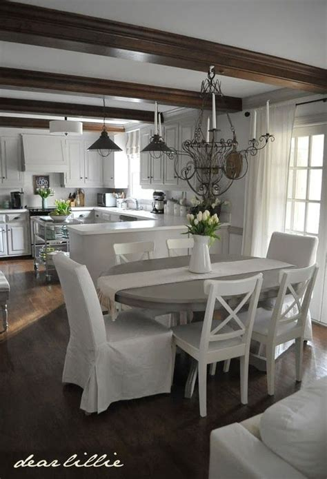 gray kitchen table  white chairs adding  spring