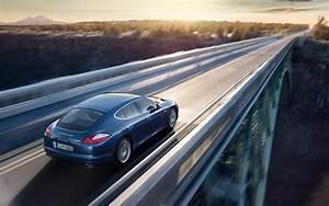 A Blue Porsche Car Running on a High Bridge, Must be in