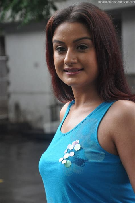 sonia agarwal posing   super tight top  jeans