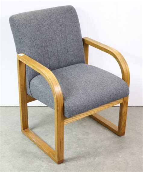 padded office chair with rounded wooden arms