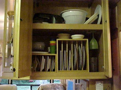 rv kitchen cabinets upright storage  plates   kitchen corrals  mugs camper