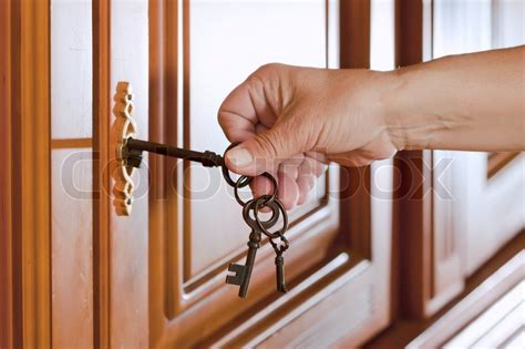 how to unlock a house door without a key locking up or unlocking the door with a key in