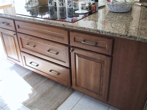 replace the cabinets and keep the granite countertops