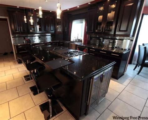 black kitchen cabinets with black countertops decor