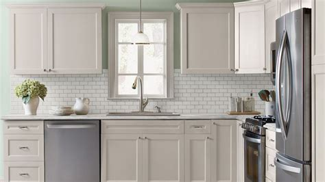 Ideas For Old Kitchen Cabinets - kitchen with antique white shaker style cabinets crown molding subway tile backsplash mint