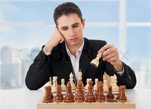 Business man playing chess, making the move   Stock Photo ...