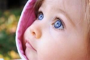Blue eyes, blonde hair, pink lips, dark skin. Beautiful ...