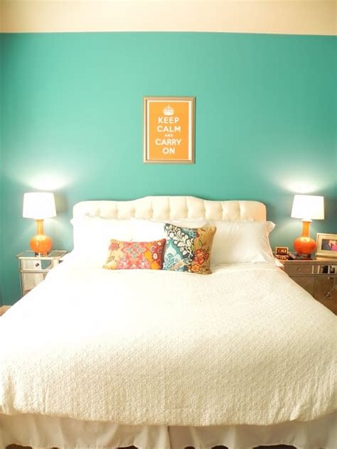 wall color with contrast of white bedding and pop of