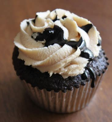 sweet deliciousness peanut butter stuffed hot fudge cupcakes