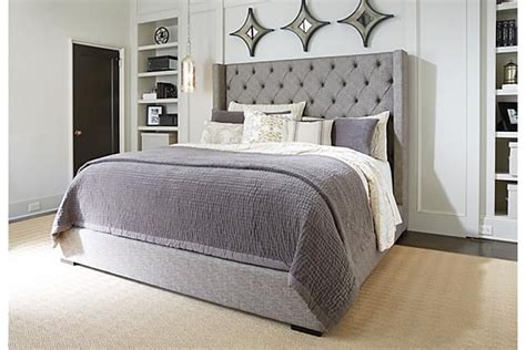 3162 grey upholstered king bed add white nightstands and white light blue bedding could
