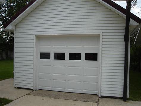garage door windows things to consider before replacing garage door panels