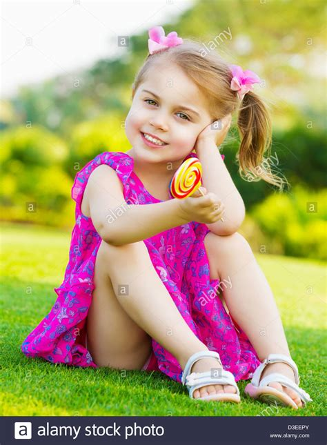 cute ls for girls photo of cute little sitting on green grass on