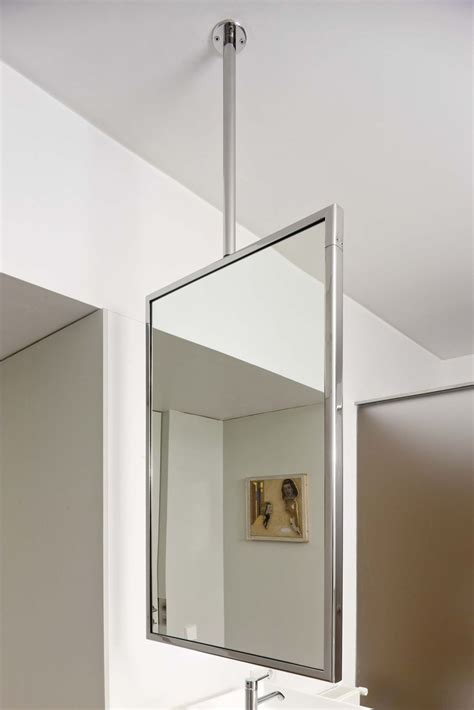 Hanging Bathroom Mirror by Quot M Quot Is A Suspended Mirror That Uses The Ceiling As Its