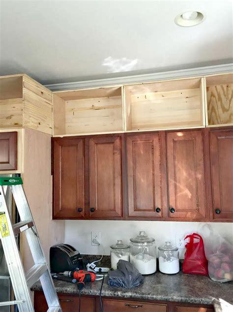 above kitchen cabinet storage ideas space above kitchen cabinets storage home design ideas 7392