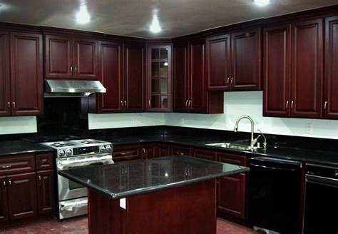 Kitchen Update Ideas - black granite countertops with dark cabinets