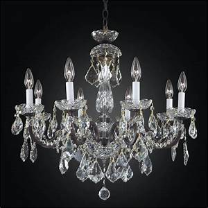 Iron and crystal chandelier light a