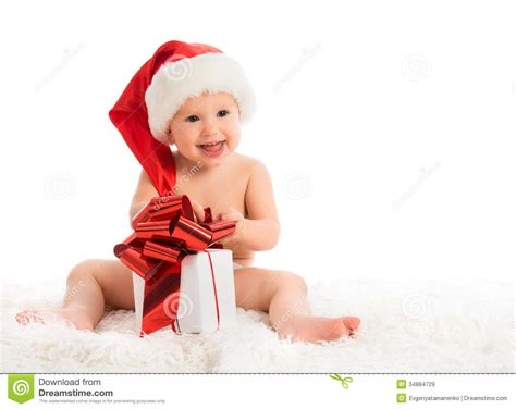 baby christmas gift happy baby in a hat with a gift isolated royalty free stock images image 34884729