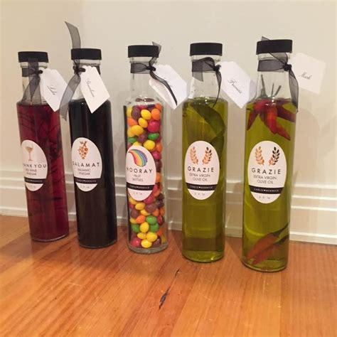 Vegetable product for healthy cooking promotion advertising. 250ml Round Glass Olive Oil Bottles Black Wadded Caps ...
