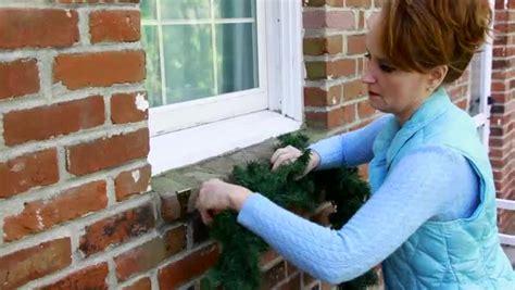 how to hang christmas lights on brick video how to hang christmas garland on brick ehow