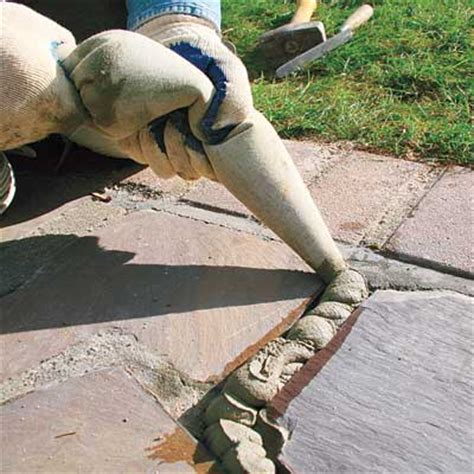 fill the joints how to repair walkway mortar