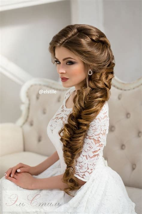 long braided wedding hairstyle via elstile wedding