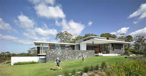 australian contemporary architecture this house with bluestone walls overlooks the landscape below contemporist