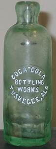 An original Coca-Cola soda bottle, from when it was still ...