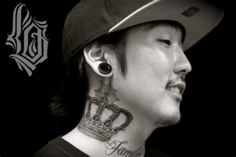 grey ink crown neck tattoo