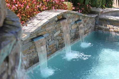 pool  spa stacked stone wall water features pool