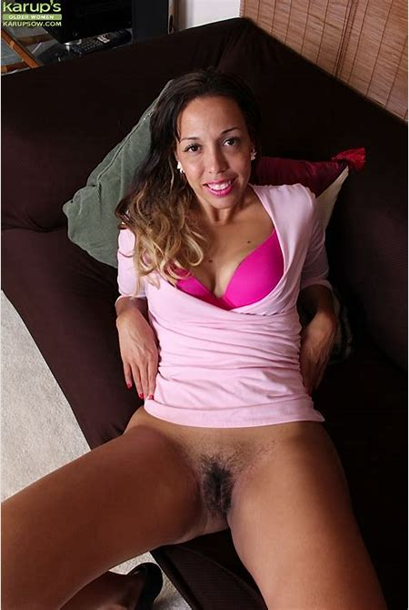 Lovely Latin MILF with hairy pussy is showing every inch of her body and that pretty big ass.
