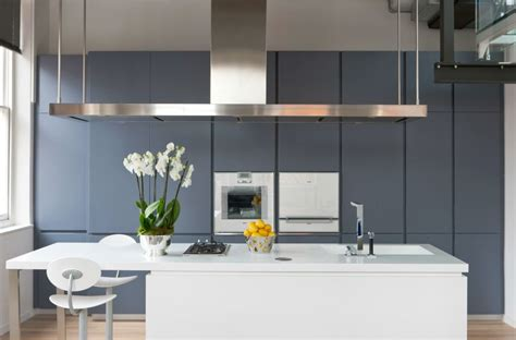 island extractor hoods for kitchens the sleek kitchen featuring the corian island unit and 7589