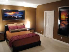 brown contemporary bedroom with sunset art hgtv