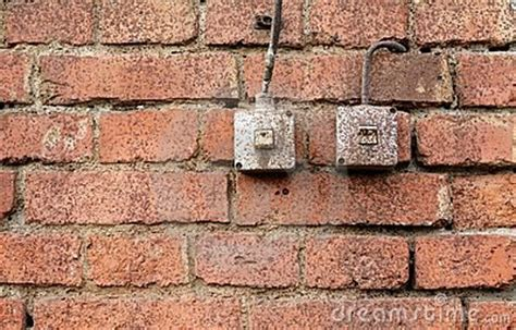 light switches on brick wall stock photography image