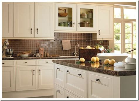 Gray kitchen cabinets are a great compromise between lively, bright white kitchen cabinets and dark, mysterious black kitchen cabinets. Towell bar over the sinkkitchen with creamy cabinets and ...