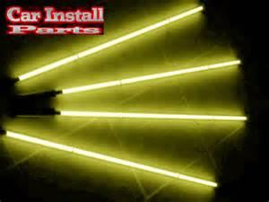 Yellow car neon lighting underbody glow in street Neons