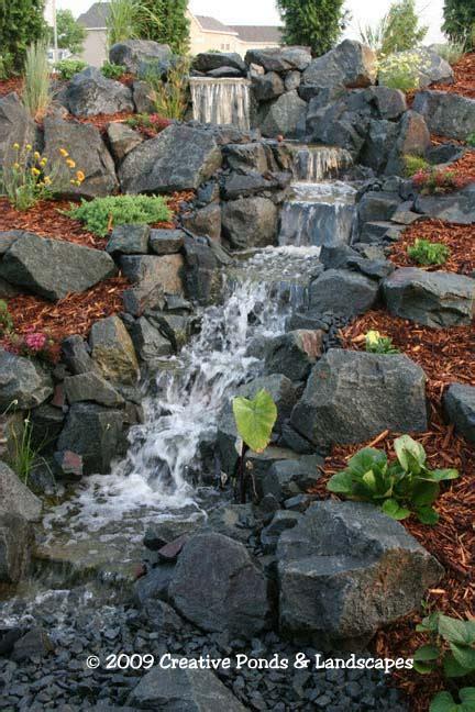 backyard pondless waterfall landscape installation  st