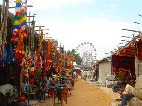 Pushkar Camel Festival Background by Colorful Market Stalls In Foreground With Fashioned