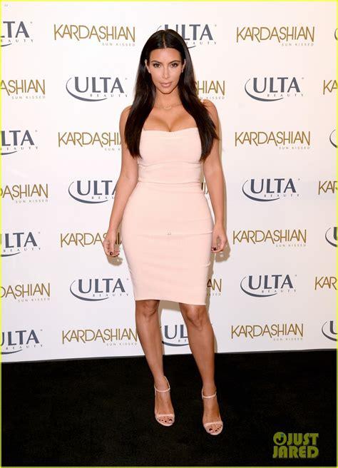 kardashian kim beauty ulta kissed sun line celebrates dermatologist dress promotes feels younger because cocktail dresses summer jared angeles los