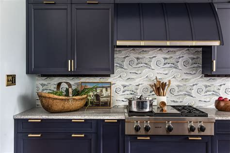 mosaic backsplash  dark blue cabinets  wolf range