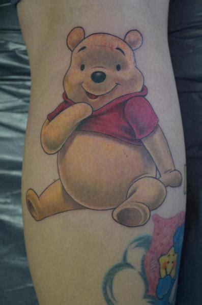 arm fantasy winnie  pooh tattoo  freaky colours