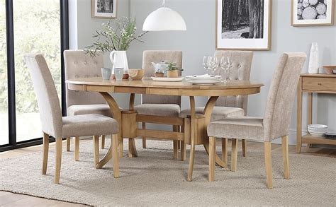 Check out our wood dining table selection for the very best in unique or custom, handmade pieces from our kitchen & dining tables shops. Townhouse Oval Oak Extending Dining Table with 6 Regent ...