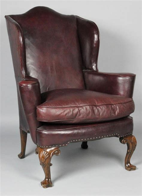 burgundy leather wing chair with nailhead trim