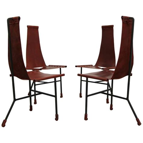 set of four custom latigo leather and steel dining chairs
