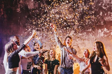 Friends Having Fun Falling Confetti Photo Free Download