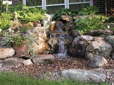 waterfalls striking complement to backyard layout