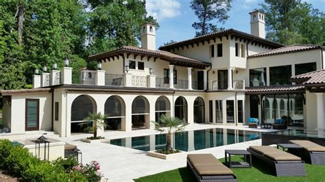 a mediterranean style home embraces outdoor living in