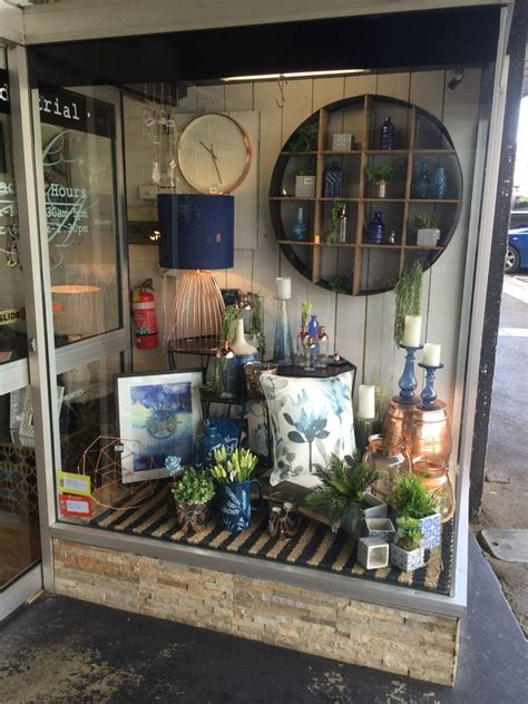 Home Decor Shop Design Ideas by This Navy And Copper Window Display From A Few Months