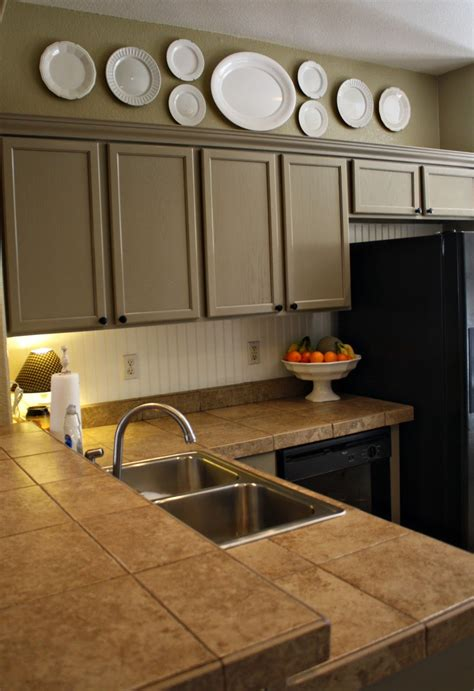 Decorating Ideas Kitchen Cabinets by Simple Clean Going In A New Direction Above My Kitchen